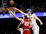 Wisconsin's Ethan Happ, left, lays up a shot as Minnesota's Joey King defends in the first half of an NCAA college basketball game Wednesday, March 2, 2016, in Minneapolis. (AP Photo/Jim Mone)