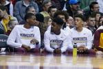 Minnesota's Dupree McBrayer, left, Kevin Dorsey, Jr., center and Nate Mason, right, are benched during an NCAA college basketball game Wednesday, March 2, 2016, in Minneapolis. Coach Richard Pitino announced Tuesday that the three will be suspended for the remainder of the season, stemming from a sexually explicit video that appeared on Dorsey's social media accounts. (AP Photo/Jim Mone)
