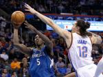 Minnesota Timberwolves center Gorgui Dieng (5) shoots as Oklahoma City Thunder center Steven Adams (12) defends in the first quarter of an NBA basketball game in Oklahoma City, Friday, March 11, 2016. (AP Photo/Sue Ogrocki)