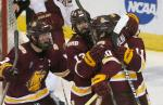 Minnesota-Duluth's Karson Kuhlman (20) celebrates his goal with teammates Andy Welinski (7) Tony Cameranesi (13) and Austin Farley (11) during the third period of the NCAA men's northeast regional championship hockey game against Boston College in Worcester, Mass., Saturday, March 26, 2016. Boston College won 3-2. (AP Photo/Michael Dwyer)