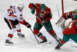 Ottawa Senators' Mika Zibanejad, left, of Sweden, takes a shot past Minnnesota Wild's Ryan Suter in the first period of an NHL hockey game Thursday, March 31, 2016, in St. Paul, Minn. Goalie Devan Dubnyk, right, made the save. (AP Photo/Jim Mone)