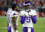 Minnesota Vikings quarterback Teddy Bridgewater (5) talks with Minnesota Vikings wide receiver Mike Wallace (11) during the second half of an NFL football game against the Arizona Cardinals, Thursday, Dec. 10, 2015, in Glendale, Ariz. (AP Photo/Ross D. Franklin)