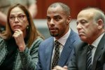 FILE - In this March 23, 2015, file photo, former NFL safety Darren Sharper, center, is flanked by his attorneys, Lisa Wayne, left, and Leonard Levine, right, in Los Angeles Superior Court. A federal judge rejected a plea deal Thursday, Feb. 18, 2016, in the rape case against the former NFL star, saying the possible nine-year sentence doesn't reflect the seriousness of the alleged crimes. (AP Photo/Nick Ut, Pool, File)