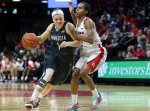 FIL - In this Dec. 31,2015, file photo, Minnesota guard Rachel Banham (1) dribbles the ball past Rutgers guard Tyler Scaife (3) during the second half of an NCAA college basketball game in Piscataway, N.J.  Banham was two days removed from her record-setting 60-point performance for Minnesota when the real life-changing moment occurred: a congratulatory tweet from her basketball idol, Kobe Bryant. (AP Photo/Mel Evans, File)