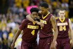Minnesota's Kevin Dorsey, left, talks with teammate Dupree McBrayer during the second half of an NCAA college basketball game against Iowa, Sunday, Feb. 14, 2016, in Iowa City, Iowa. Iowa won 75-71. (AP Photo/Charlie Neibergall)