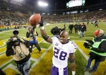 Minnesota Vikings' Adrian Peterson celebrates after an NFL football game against the Green Bay Packers Sunday, Jan. 3, 2016, in Green Bay, Wis. The Vikings won 20-13. (AP Photo/Mike Roemer)