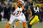 Cincinnati Bengals tackle Andre Smith (71) blocks Pittsburgh Steelers outside linebacker Chris Carter (54) during the fourth quarter of an NFL football game in Pittsburgh, Sunday, Dec. 15, 2013. The Steelers won 30-20. (AP Photo/Gene J. Puskar)