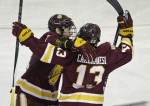 Minnesota-Duluth center Tony Cameranesi (13) celebrates his goal with teammate Carson Soucy, left, in the third period of a regional semifinal game against Providence in the NCAA college hockey tournament, Friday, March 25, 2016, in Worcester, Mass. (AP Photo/Elise Amendola)