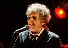 AP DO NOT REUSE FILE - In this Jan. 12, 2012 file photo, Bob Dylan performs in Los Angeles.  President Barack Obama and first lady Michelle Obama will honor a diverse cross-section of political and cultural icons — including former Secretary of State Madeleine Albright, astronaut John Glenn, basketball coach Pat Summitt and rock legend Bob Dylan — with the Medal of Freedom at a White House ceremony Tuesday. The Medal of Freedom is the nation's highest civilian honor. It's presented to individuals who have made especially meritorious contributions to the national interests of the United States, to world peace or to other significant endeavors. (AP Photo/Chris Pizzello, File)