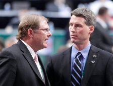 Minnesota Wild owner Craig Leipold, left, talks with Wild general manager Chuck Fletcher in the first round of the National Hockey League entry draft Friday June, 24, 2011 in St. Paul, Minn..(AP Photo/Andy King)