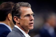 Minnesota Vikings general manager Rick Spielman walks on the field before an NFL football game against the New Orleans Saints in New Orleans, Sunday, Sept. 21, 2014. (AP Photo/Bill Haber)