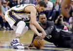 Utah Jazz guard Raul Neto, left, and Minnesota Timberwolves forward Shabazz Muhammad (15) battle for a loose ball during the second quarter of an NBA basketball game Friday, April 1, 2016, in Salt Lake City. (AP Photo/Rick Bowmer)