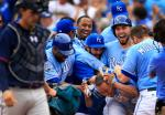 Kansas City Royals players celebrate with teammate Terrance Gore after he scored the winning run during the tenth inning of a baseball game against the Minnesota Twins at Kauffman Stadium in Kansas City, Mo., Sunday, April 10, 2016. The Royals defeated the Twins 4-3 in ten innings. (AP Photo/Orlin Wagner)