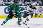 Dallas Stars defenseman Johnny Oduya (47) skates with the puck against Minnesota Wild right wing Jason Pominville (29) during the second period of Game 1 in a first-round NHL hockey Stanley Cup playoff series Thursday, April 14, 2016, in Dallas. (AP Photo/LM Otero)