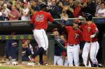 Minnesota Twins' Miguel Sano, left, is welcomed at the dugout by manager Paul Molitor and Byung Ho Park, right, of South Korea, after scoring on a hit by Trevor Plouffe off Los Angeles Angels pitcher Garrett Richards during the sixth inning of a baseball game Friday, April 15, 2016, in Minneapolis. (AP Photo/Jim Mone)