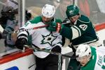 Minnesota Wild's Ryan Suter, right, keeps Dallas Stars' Jamie Benn close to the board with his stick during the first period of Game 4 in the first round of the NHL Stanley Cup hockey playoffs Wednesday, April 20, 2016, in St. Paul, Minn. (AP Photo/Jim Mone)