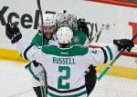 Dallas Stars' Jason Demers, left, and Kris Russell celebrate with goalie Antti Niemi, of Finland, after the Stars beat the Minnesota Wild 3-2 in Game 4 in the first round of the NHL Stanley Cup hockey playoffs Wednesday, April 20, 2016, in St. Paul, Minn. (AP Photo/Jim Mone)