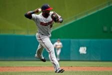 Minnesota Twins third baseman Miguel Sano throws to first base for the out on Washington Nationals' Anthony Rendon during the third inning of an interleague baseball game at Nationals Park, Saturday, April 23, 2016, in Washington. (AP Photo/Alex Brandon)