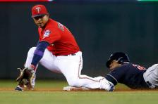 Cleveland Indians' Rajai Davis, right, beats the throw to Minnesota Twins shortstop Eduardo Escobar to steal second base in the fifth inning of a baseball game Monday, April 25, 2016, in Minneapolis. (AP Photo/Jim Mone)