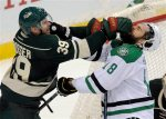 Minnesota Wild's Nate Prosser, left, gives the Dallas Stars' Patrick Eaves, right, a face full of gloves in the second period of an NHL hockey game, Tuesday, Feb. 9, 2016, in St. Paul, Minn. Dallas won 4-3. (AP Photo/Tom Olmscheid)