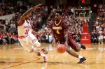 Minnesota guard Kevin Dorsey (4) goes around Indiana guard Kevin Yogi Ferrell (11) in the first half of an NCAA college basketball game in Bloomington, Ind., Saturday, Jan. 30, 2016. (AP Photo/AJ Mast)