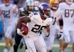 Minnesota Vikings running back Adrian Peterson (28) runs the ball during the NFL Pro Bowl football game, Sunday, Jan. 31, 2016, in Honolulu.  (Jeff Haynes/AP Images for Panini)
