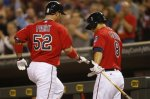 Minnesota Twins' Byung Ho Park of South Korea is congratulated by Kurt Suzuki after Park's solo home run off Milwaukee Brewers pitcher Chase Anderson in the fourth inning of a baseball game Monday, April 18, 2016, in Minneapolis. (AP Photo/Jim Mone)