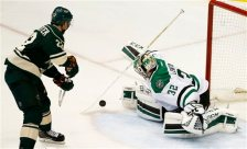 Dallas Stars goalie Kari Lehtonen (32) swats away a shot by Minnesota Wild right wing Nino Niederreiter (22) during the second period of Game 6 in the first round of the NHL Stanley Cup playoffs in St. Paul, Minn., Sunday, April 24, 2016. (AP Photo/Ann Heisenfelt)