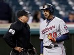 Minnesota Twins' Chris Colabello (20) argues with home plate umpire Cory Blaser after Balser called him out on strikes in the sixth inning of a baseball game against the Cleveland Indians Monday, May 5, 2014, in Cleveland. (AP Photo/Mark Duncan)