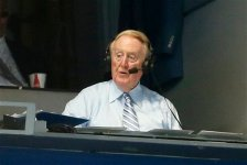Sportscaster Vin Scully broadcasts from a press box booth at Dodger Stadium during the baseball game between the Los Angeles Dodgers and Colorado Rockies, Monday, Sept. 14, 2015, in Los Angeles. (AP Photo/Danny Moloshok)