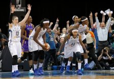 Minnesota Lynx guard Lindsay Whalen (13), center Sylvia Fowles (34), guard Seimone Augustus (33), forward Rebekkah Brunson (32) and forward Maya Moore, rear, celebrate after the Lynx defeating the Los Angeles Sparks 67-65 during Game 1 of the WNBA basketball Western Conference semifinals in Minneapolis, Friday, Sept. 18, 2015. (AP Photo/Ann Heisenfelt)