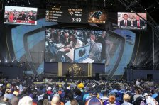 NFL fans watch from selection square during the last day of the 2015 NFL Draft,   Saturday, May 2, 2015, in Chicago. (AP Photo/Charles Rex Arbogast)