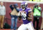 Minnesota Vikings wide receiver Greg Jennings catches a 5-yard touchdown pass during the second half of an NFL football game against the Green Bay Packers, Sunday, Nov. 23, 2014, in Minneapolis. The Packers won 24-21. (AP Photo/Jim Mone)