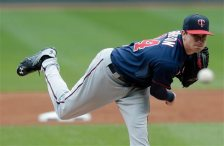 Minnesota Twins starting pitcher Kyle Gibson delivers in the first inning of the first baseball game of a doubleheader against the Cleveland Indians, Wednesday, Sept. 30, 2015, in Cleveland. (AP Photo/Tony Dejak)