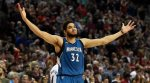 Minnesota Timberwolves center Karl-Anthony Towns celebrates after hitting the game-winning shot in an NBA basketball game against the Portland Trail Blazers in Portland, Ore., Saturday, April 9, 2016. The Timberwolves won 106-105. (AP Photo/Steve Dykes)