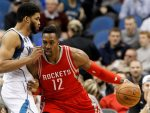 Houston Rockets center Dwight Howard, right, drives against Minnesota Timberwolves center Karl-Anthony Towns, left, during the first half of an NBA basketball game in Minneapolis, Monday, April 11, 2016.  (AP Photo/Ann Heisenfelt)