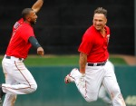 Minnesota Twins left fielder Oswaldo Arcia celebrates with teammate Eduardo Nunez after Arcia drove in the winning run against the Los Angeles Angels in the 12th inning of their baseball game, Sunday April 17, 2016 in Minneapolis. The Twins won 3-2. (AP Photo/Andy Clayton-King)