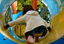 child playing playground tube flickr