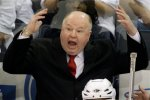 Washington Capitals coach Bruce Boudreau disagrees with penalty called against the Capitals in the third period against the Pittsburgh Penguins in Game 3 of an NHL hockey second-round playoff series, in Pittsburgh on Wednesday, May 6, 2009. The Penguins won in overtime, 3-2. (AP Photo/Gene J. Puskar)