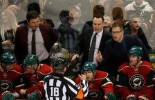 Minnesota Wild assistant coach Andrew Brunette, left, head coach John Torchetti, center, and assistant coach Darryl Sydor, right, talk with referee Greg Kimmerly (18) during the third period of an NHL hockey game against the Colorado Avalanche in St. Paul, Minn., Tuesday, March 1, 2016. The Wild won 6-3. (AP Photo/Ann Heisenfelt)