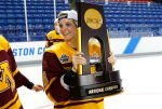 Minnesota's Amanda Kessel holds the championship trophy after they defeated  Boston College 3-1 in the women's Frozen Four championship college hockey game in Durham, N.H. Sunday, March 20, 2016. (AP Photo/Winslow Townson)