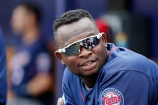 Minnesota Twins' Miguel Sano talks with teammates in the dugout during a spring training baseball game against the Tampa Bay Rays on Friday, March 25, 2016, in Port Charlotte, Fla. (AP Photo/Tony Gutierrez)