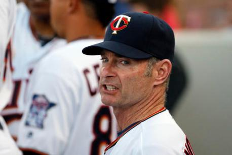 Minnesota Twins manager Paul Molitor talks to his team in the dugout during the first inning of a spring training baseball game against the Boston Red Sox on Wednesday, March 16, 2016, in Fort Myers, Fla. (AP Photo/Tony Gutierrez)