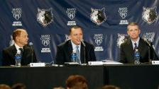 Tom Thibodeau, center, addresses the media and a gathering of fans after he was introduced as the new Minnesota Timberwolves NBA basketball head coach Tuesday, April 26, 2016, in Minneapolis. Listening, left, is Timberwolves owner Glen Taylor, and right, new general manager Scott Layden who was also introduced .(AP Photo/Jim Mone)