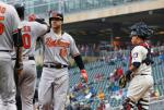 Baltimore Orioles' Chris Davis (19) is congratulated by teammates following his two-run home run off Minnesota Twins pitcher Phil Hughes in the fourth inning of a baseball game Wednesday, May 11, 2016, in Minneapolis. Not watching, right, is Twins catcher Juan Centeno. (AP Photo/Jim Mone)