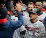 Minnesota Twins' Juan Centeno is congratulated by teammates after hitting a two-run home run off Cleveland Indians starting pitcher Corey Kluber in the fifth inning of a baseball game, Saturday, May 14, 2016, in Cleveland. Eddie Rosario scored on the play. (AP Photo/Tony Dejak)