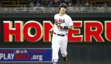 Minnesota Twins' Joe Mauer rounds the bases on his solo home run off Kansas City Royals starting pitcher Ian Kennedy during the first inning of a baseball game in Minneapolis, Monday, May 23, 2016. (AP Photo/Ann Heisenfelt)