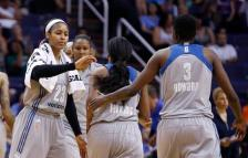 Minnesota Lynx's Maya Moore (23) celebrates a run against the Phoenix Mercury with Natasha Howard (3) and Jia Perkins, middle, during the second half of a WNBA basketball game Wednesday, May 25, 2016, in Phoenix. The Lynx defeated the Mercury 85-78. (AP Photo/Ross D. Franklin)