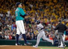 Seattle Mariners starting pitcher Felix Hernandez, left, waits as Minnesota Twins' Miguel Sano rounds the bases on a home run during the second inning of a baseball game Friday, May 27, 2016, in Seattle. (AP Photo/Elaine Thompson)