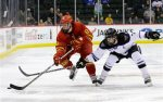 Ferris State forward Andrew Dorantes (8) controls the puck past Minnesota State Mankato defenseman Zach Palmquist (7) during the second period of a WCHA Final Five college semifinal hockey game in St. Paul, Minn., Friday, March 20, 2015. (AP Photo/Ann Heisenfelt)